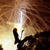 Newburyport: The Yankee Homecoming fireworks explode behind the Swan Fountain at the Bartlet Mall in Newburyport Saturday night. Jim Vaiknoras/Staff photo