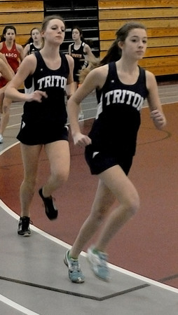 North Andover: Triton's Lizzy Willmonton and Adele Kneeland compete in the Viking's track Meet at North Andover high Saturday morning. Jim Vaiknoras/Staff photo