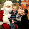 Salisbury: Brady Neary, 17 months, was none to happy to visit Santa so  needed a little help from his mom Stacy, to pose with his big brother Cameron, 5, at the annual Breakfast with Santa at the Hilton Center in Salisbury Saturday morning. Jim Vaiknoras/Staff photo