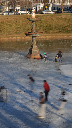 Newburyport: Skaters enjoy the frozen Frog Pond at teh Bartlett Mall in Newburyport on a cold bright Saturday afternoon.