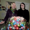 Amesbury: Deb Pagley and her daughter Lindsey of Parke Place gift shop in Amesburyfill a bowl with small ornaments that they are selling to raise money for My Neighbors Table. Jim Vaiknoras/Staff photo