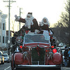 Amesbury: Santa and Mrs Claus arrive in an antique fire truck at the annual Santa Parade in Amesbury Saturday. Jim Vaiknoras/Staff photo