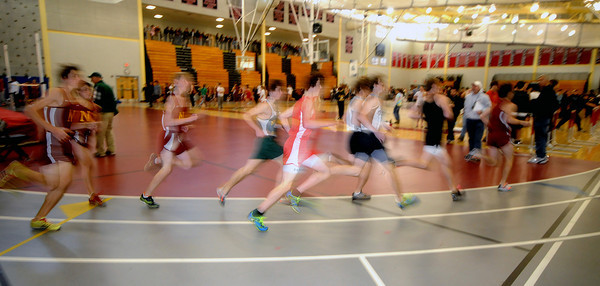Nroth Andover; Runners from Triton, Newburyport North Reading , Masco and Ipswich competet in the 2 mile run at a track meet in North Andover Saturday morning. JIm Vaiknoras/Staff photo