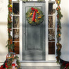 Newburyport: A sled with bells, holly and a wreath with pears decorate this front door on High Street in Newburyport. Jim Vaiknoras/Staff photo