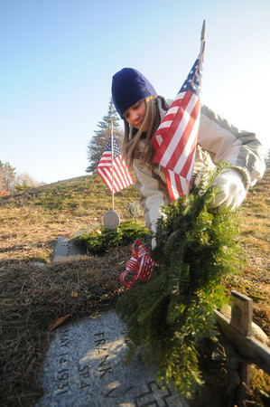 Amesbury: Kelsey Chadonnet whose fiance Sgt. Jordan Shay of Amesbury who was killed in Iraq last year lays a wreath on a soldiers grave at Union Cemetery in Amesbury Saturday morning.With the help of Amesbury Veterans' Services office and Boy Scout Troop 4 of Amesbury, the Wreaths for Heroes program is providing wreaths to family and friends who wish to adorn the graves of beloved veterans this holiday season. Jim Vaiknoras/ Staff photo
