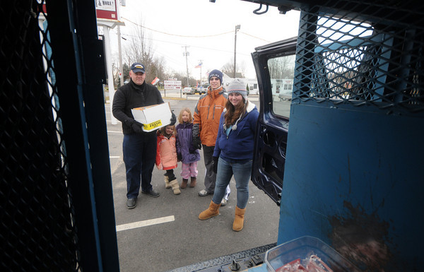 Salisbury: Reserve Officer Dennis Lucia, his daughters Rylee and Delaney, along with Kyle  and Kelsey Roy work a food drive in Salisbury. Jim Vaiknoras/Staff photo