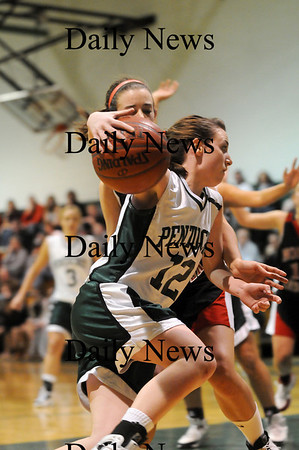 West Newbury: Erin McNamara (12) of Pentucket drives past a North Andover defender during Monday night's game in West Newbury. Photo by Ben Laing/Staff Photo