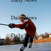 Newburyport: Jeremy Grabowski, 13, of Newburyport, fires off a shot while skating on the Mall Monday afternoon. The teen, who plays youth hockey, was making the most of the late afternoon daylight and cold temperatures. Photo by Ben Laing/Staff Photo