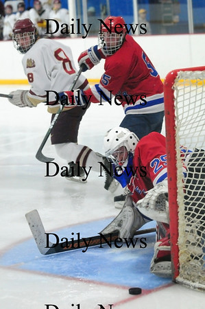 Stoneham: Newburyport's Derek Freeman (8) watches he shot slide just wide of the net and Tewksbury goalie James Berkeley (29). The Clippers would battle to a 6-2 win Friday night. Photo by Ben Laing/Staff Photo
