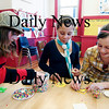 Newburyport: Sarah Simon, right, Savannah Waterworth, center, and Cassie Peterson, left, do some arts and crafts at the Kelley School youth center Monday afternoon. Newburyport Youth Services are celebrating their 5th anniversary this week. Photo by Ben Laing/Staff Photo