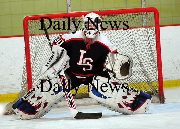 Newburyport: Lincoln-Sudbury goalie, John Burke (30), watches a shot sail by during their game against Newburyport Thursday afternoon. Photo by Ben Laing/Staff Photo
