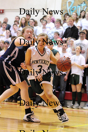 Amesbury: Pentucket's Emily Lane (3) drives past a Swampscott defender during their 69-49 win Friday night. Photo by Ben Laing/Staff Photo
