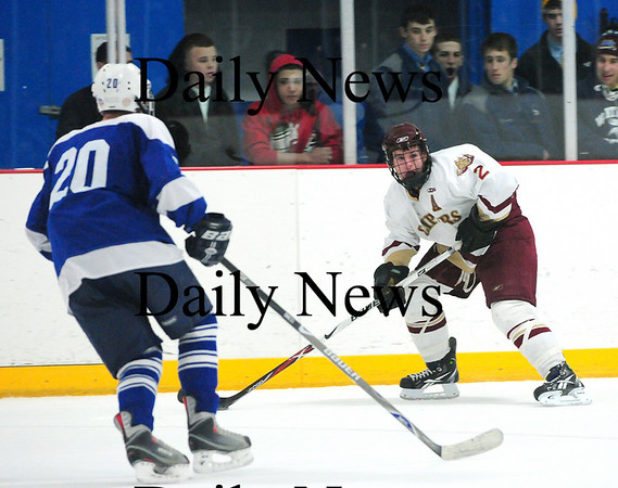 Stoneham: Newburyport's Billy Boudreau (2) looks to move the puck during Tuesday night's 7-1 win over Methuen. Photo by Ben Laing/Staff Photo