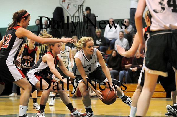 West Newbury: Pentucket's Emily Lane (3) scoops up a loose ball amongst a crowd of North Andover players during Monday night's game. Photo by Ben Laing/Staff Photo