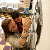 Salisbury: Taylor Paquette, 14, and Kyle Wheeler, 12, both of Salisbury, paint a mural Wednesday afternoon at the Salisbury Boys and Girls Club. Photo by Ben Laing/Staff Photo
