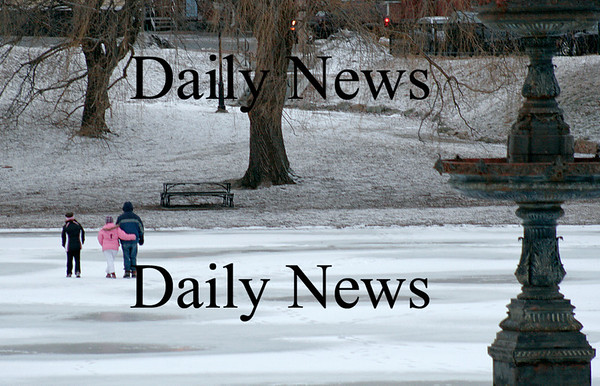 Newburyport: Three youngsters cut across the pond at the Mall in Newburyport Wednesday afternoon, despite the mix of light rain and snow that fell in the area. Photo by Ben Laing/Staff Photo