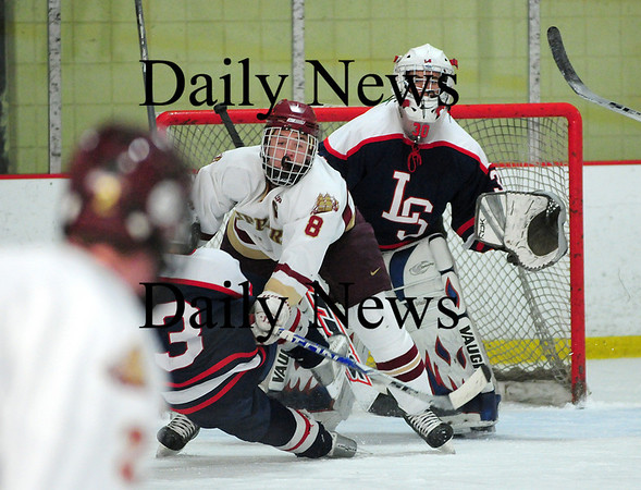 Newburyport: Newburyport's Derek Freeman (8) clears some space in front of the Lincoln-Sudbury net Thursday afternoon, as the Clippers skated to a 3-0 victory. Photo by Ben Laing/Staff Photo