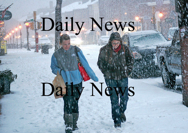Newburyport: Christine Mccoy, left, and Kelte Foster, walk home up State Street in Newburyport Tuesday afternoon, after parking their car in a municipal lot during the snow emergency. Photo by Ben Laing/Staff Photo