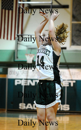 West Newbury: Nicole Viselli (14) of Pentucket launches a three pointer during Monday night's game against North Andover. Photo by Ben Laing/Staff Photo