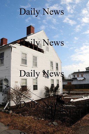 Newbury: Siding was ripped from this home on High Road in Newbury during last night's storm, which pounded the region, knocking out power and damaging trees and property in the area.  Photo by Ben Laing/Staff Photo