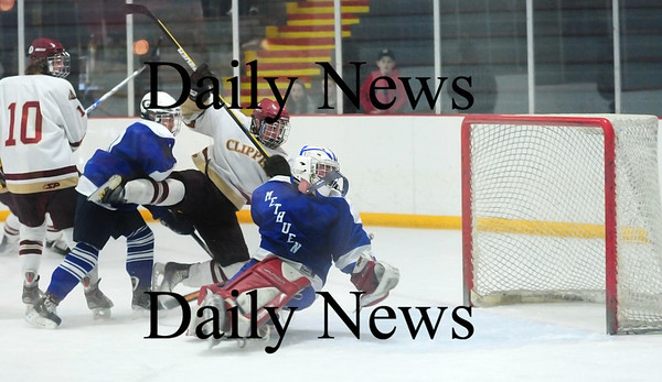 Stoneham: Newburyport's Gaven LaValley (7) gets knocked over the Methuen goal after sliding the puck into the net for the Clipper's second goal of Tuesday night's state tournament opener. Newburyport would go on to win, 7-1. Photo by Ben Laing/Staff Photo