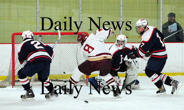 Newburyport: Newburyport's Derek Freeman (8) can't settle a loose puck as it slips through his legs during the Clippers 3-0 win over Lincoln-Sudbury Thursday afternoon. Photo by Ben Laing/Staff Photo