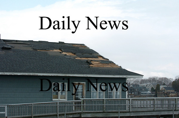 Newburyport: The roof on a building at Harbor Marina on Water Street saw some damage from last night's storm. Photo by Ben Laing/Staff Photo