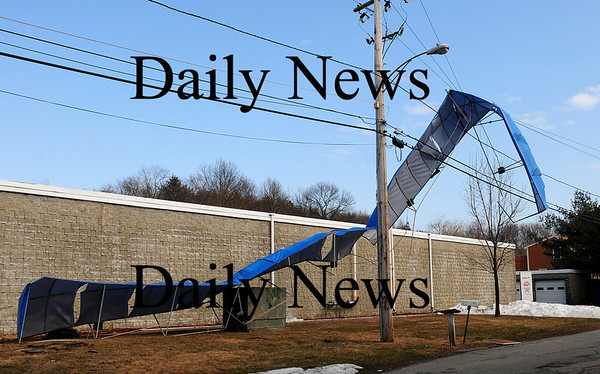 Amesbury: A awning at the EZ Car Wash in Amesbury blew off and got tangled in some power lines after last night's storm blew through the area. Photo by Ben Laing/Staff Photo