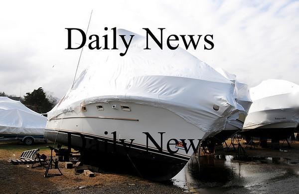 Newburyport: A boat at Newburyport Marina on Merrimack Street was blown off its jacks during last nights storm.  Photo by Ben Laing/Staff Photo