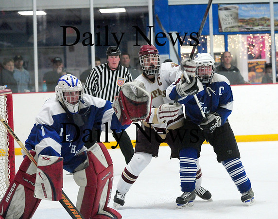 Stoneham: Newburyport's Derek Freeman (8) battles with a Methuen defender in front of their net during Tuesday night's 7-1 win in the opening round of the state tournament. Photo by Ben Laing/Staff Photo