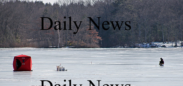 West Newbury: An ice-fisherman leaves the shelter of his hut to check his lines on the Artichoke Resivior Monday afternoon. Photo by Ben Laing/Staff Photo