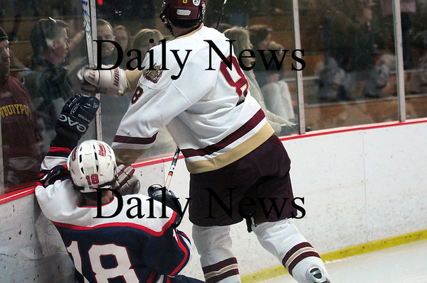 Newburyport: Lincoln-Sudbury's Jackson Rimpas (18) gets buried into the boards by Newburyport's Derek Freeman (8) as the Clippers sailed past the Warriors 3-0. Photo by Ben Laing/Staff Photo