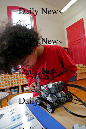 Newburyport: Isaiah Linscott, 9, of Newburyport, puts the finishing touches on his Lego robot at the Kelly School during one of Wednesday's school vacation programs offered by Newburyport Youth Services. Photo by Ben Laing/Staff Photo