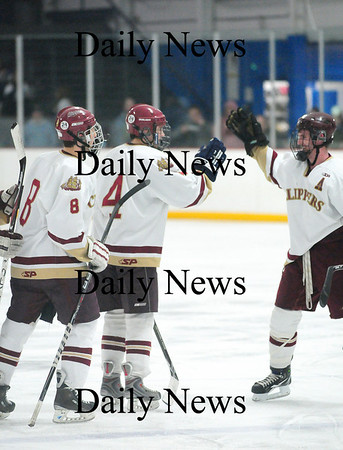 Stoneham: Cam Roy (4) is congratulated by his Clipper teammates after scoring in Newburyport's 7-1 win over Methuen. Photo by Ben Laing/Staff Photo