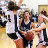 Amesbury: Swampscott's Kara Gilberg (32) gets fouled by Pentucket's Nicole Viselli (14) during Friday night's game in Amesbury. Photo by Ben Laing/Staff Photo