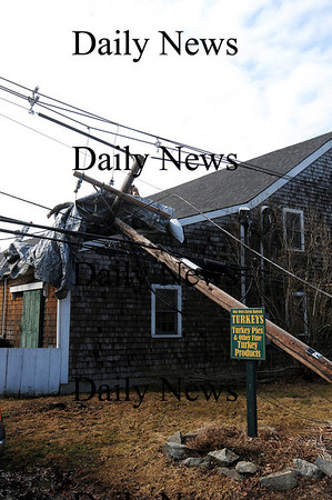 Newbury: A downed telephone pole landed on the roof at Tendercrop Farm during last night's storm.  Photo by Ben Laing/Staff Photo