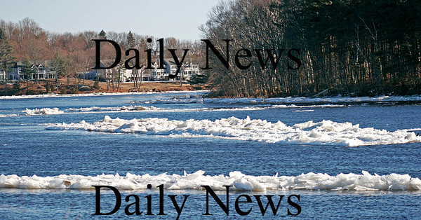 Amesbury: Ice flows slowly drift down the Merrimack River off of Point Shore in Amesbury Monday afternoon. Photo by Ben Laing/Staff Photo