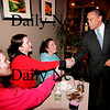 Newburyport: Governor Deval Patrick shakes hands with Ashley Hardenstine, and Kelly Donahue of Groveland, and their friend Tyler Tanner, of Georgetown, left, during his visit to Caffe Disiena in Newburyport Monday evening. Photo by Ben Laing/Staff Photo