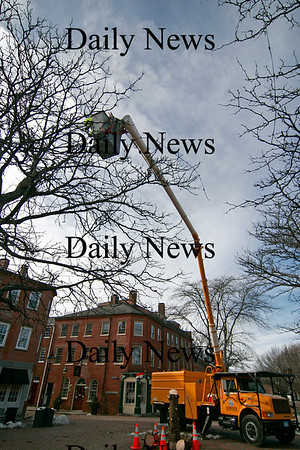 Newburyport: DPW workers remove the remaining Christmas lights in Market Square in Newburyport Monday morning, after taking down the Christmas tree earlier in the day. Photo by Ben Laing/Staff Photo