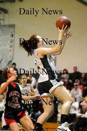 West Newbury: Pentucket's Jessica Gayton (22) glides to the hoop during Monday night's game against North Andover. Photo by Ben Laing/Staff Photo