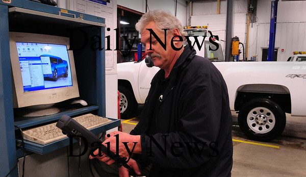 Salisbury: Bob Moore, service manager at Fraser, uses a hand-held vehicle scan tool connected to a pc that takes information from a vehicle's electrical system. They can go online and check with some auto manufacturers for any software updates. Bryan Eaton/Staff Photo