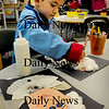 Salisbury: Brenden Leighton, 6, works on his portrait of George Washington at Salisbury Elementary School on Tuesday. The kindergartners were learning about the presidents, including Washington whose birthday was Monday. Bryan Eaton/Staff Photo