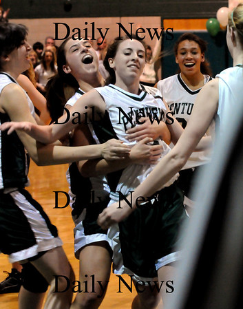 West Newbury: Erin McNamara gets hugs from her Pentucket teammates as she scored her 1000th point in a foul shot against Triton last night in West Newbury. Bryan Eaton/Staff Photo