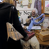 Amesbury: Liz Adell, right, of Steppe Up Inn checks out some items for Diane Pollard of Ipswich, formerly of Amesbury. Bryan Eaton/Staff Photo