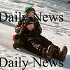 Amesbury: Peyton McKee, front and Cam Kelleher, both 5, slide down a hill at the Cashman School in Amesbury before the end of their school day Tuesday afternoon. LInda Jensen's kindergartners go on the mostly shaded hill, which can stay snow-covered into April, just about every day, weather permitting before they catch the school bus. Bryan Eaton/Staff Photo