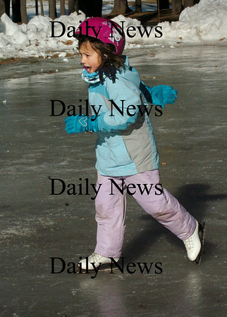 Amesbury: Lily Robinson, 6, glides along on the ice getting her stride after falling a couple times before. She was at the skating rink at Amesbury Town Park practicing her skills with sister, Avry, 5, and her mother, Kristin of Amesbury. Bryan Eaton/Staff Photo