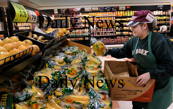 Rowley: Kelly Dwan of Amesbury works in the produce department of the Market Basket in Rowley. Bryan Eaton/Staff Photo