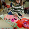 Amesbury: Rowan Brennan, 3, works on a Valentine poster in Mary Ellen Uhlarik's class at Amesbury Elementary School on Wednesday morning. The preschooler is planning on giving the artwork to her mother. Bryan Eaton/Staff Photo