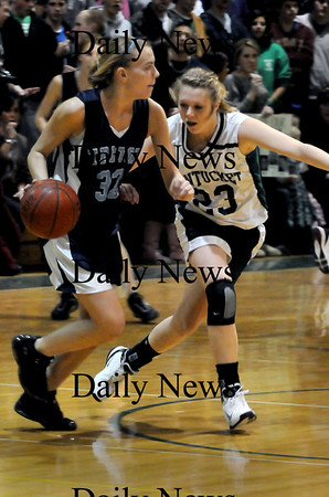 West Newbury: Triton's Jen Rock moves down court with resistance from Pentucket's Holly Jakbsons. Bryan Eaton/Staff Photo