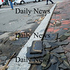 Newburyport: Shingles were abundant in downtown Newburyport being blown from rooftops in the 50 mph winds, here on Middle Street. Bryan Eaton/Staff Photo